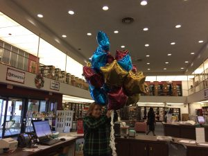 Elin Woods of the Altoona Area Public Library celebrates Go Live with a gift of star balloons.